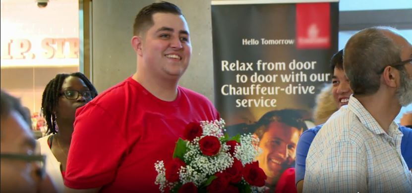 Jorge-Red-Shirt-Holding-Flowers-90-Day-Fiance