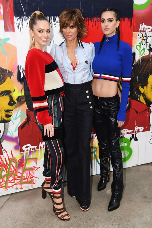 VENICE, CA - FEBRUARY 08: (L-R) Model Delilah Hamlin, actress Lisa Rinna, and Amelia Belle attend the TommyLand Tommy Hilfiger Spring 2017 Fashion Show on February 8, 2017 in Venice, California. (Photo by Jeff Kravitz/FilmMagic)