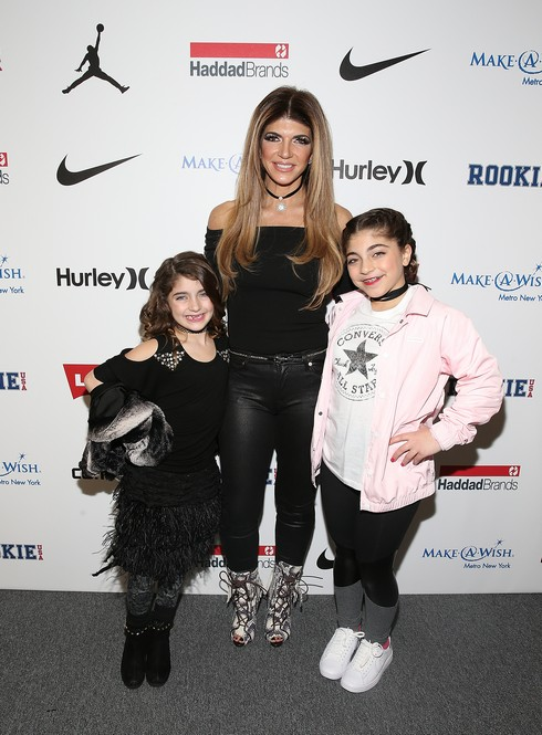NEW YORK, NY - FEBRUARY 15: TV personality Teresa Giudice (C) attend the Rookie USA Fashion Show during New York Fashion Week: The Shows at Skylight Clarkson Sq on February 15, 2017 in New York City. (Photo by Bennett Raglin/Getty Images for Haddad)