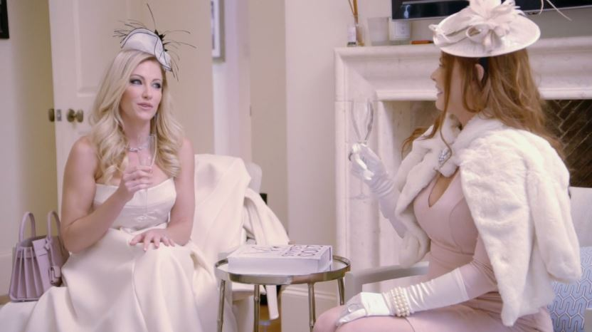 Brandi Redmond and Stephanie Hollman compliment one another on their outfits for the Honest Tea