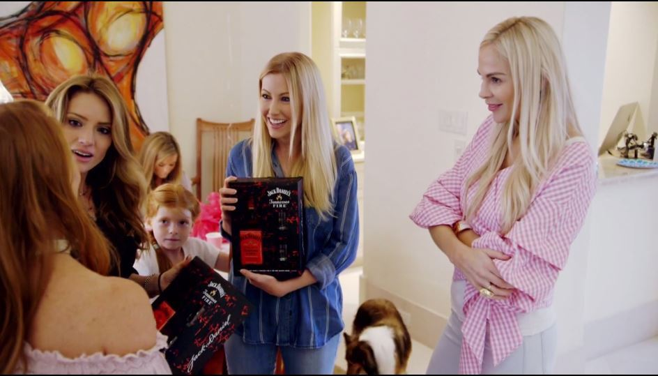 Kameron-Westcott-looks-on-as-Brandi-exchanges-gifts-and-invitations-to-her-friends