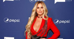 "Kim Zolciak Says Daughter Ariana Biermann Was ""Dying"" To Be 18 & Get Lips Done"