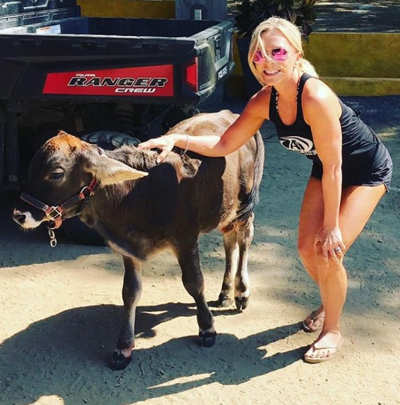 Tamra Petting A Cow