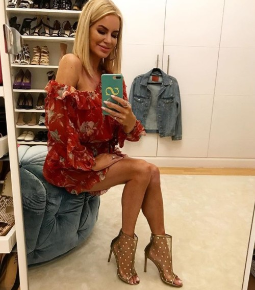 Caroline Stanbury Showing Off Her Outfit